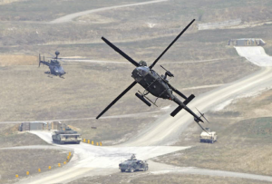A U.S. Army Kiowa Warrior helicopter participates in a joint live-fire military exercise with the Republic of Korea in Pocheon, south of the Demilitarized Zone separating North and South Korea. [Reuters]