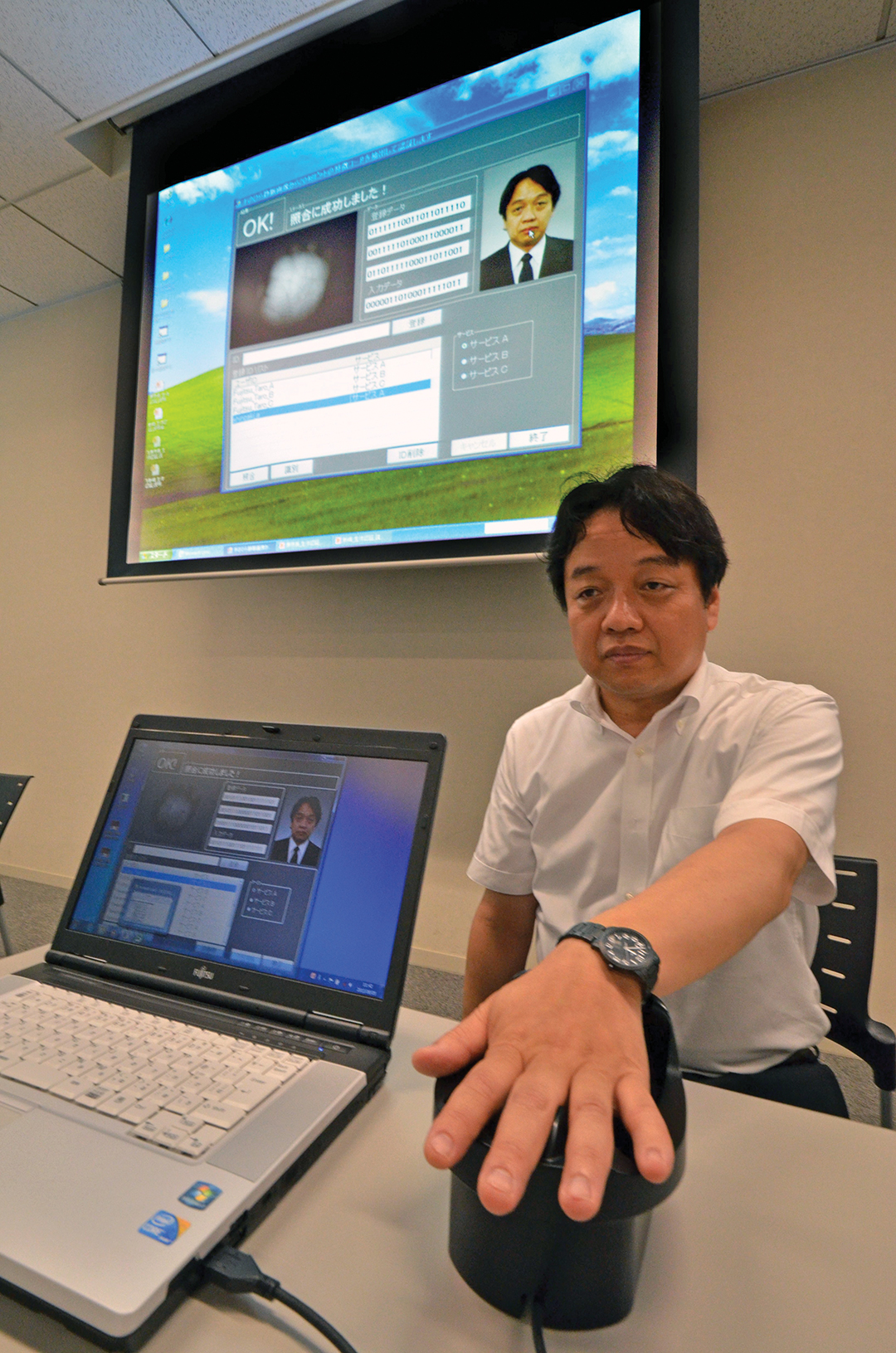 A Japanese researcher demonstrates a new biometric coding technology for extracting and matching the binary codes from palm vein images at Fujitsu's Tokyo headquarters. AFP/GETTY IMAGES