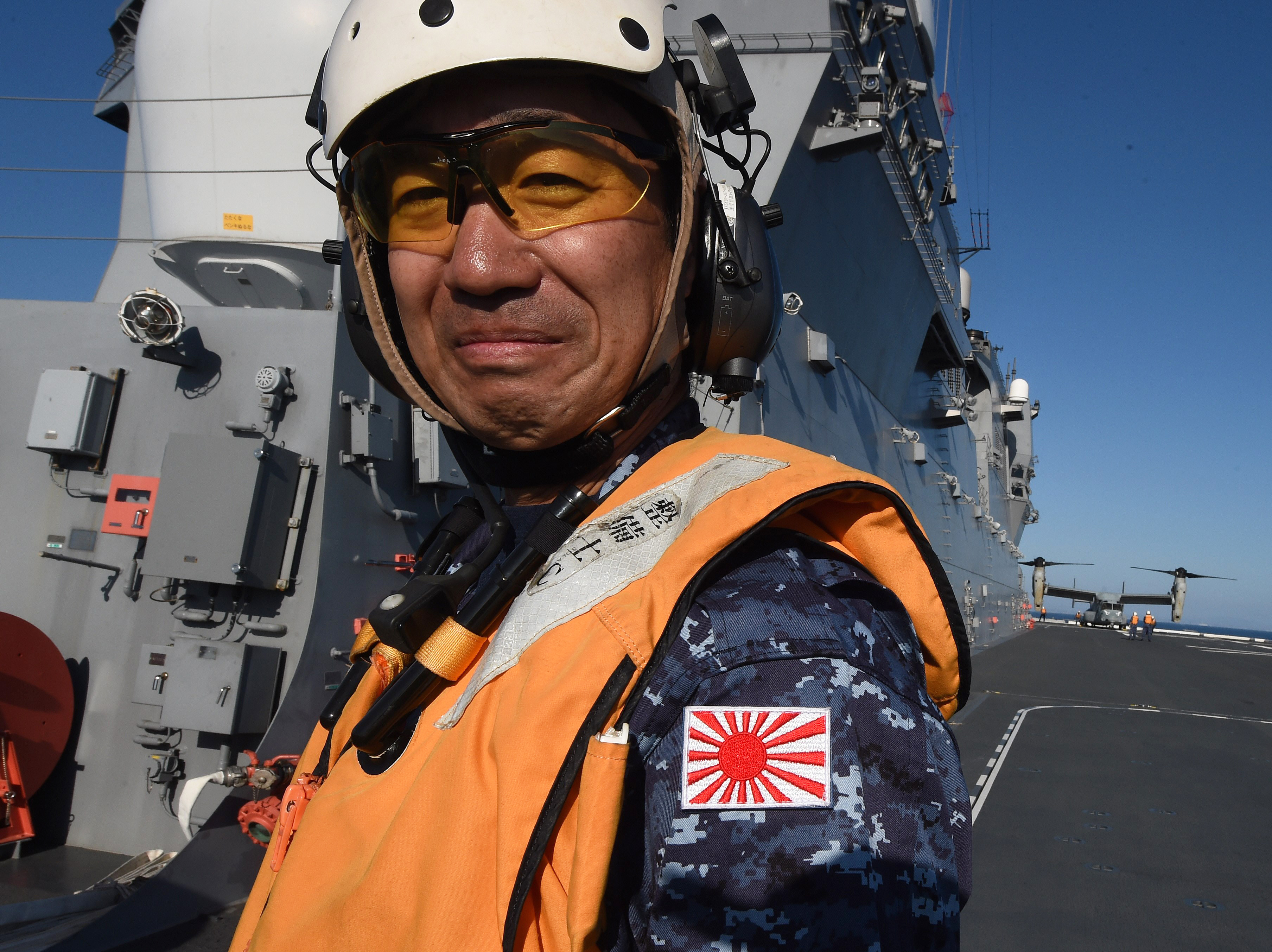 Japan moves toward less restricted military