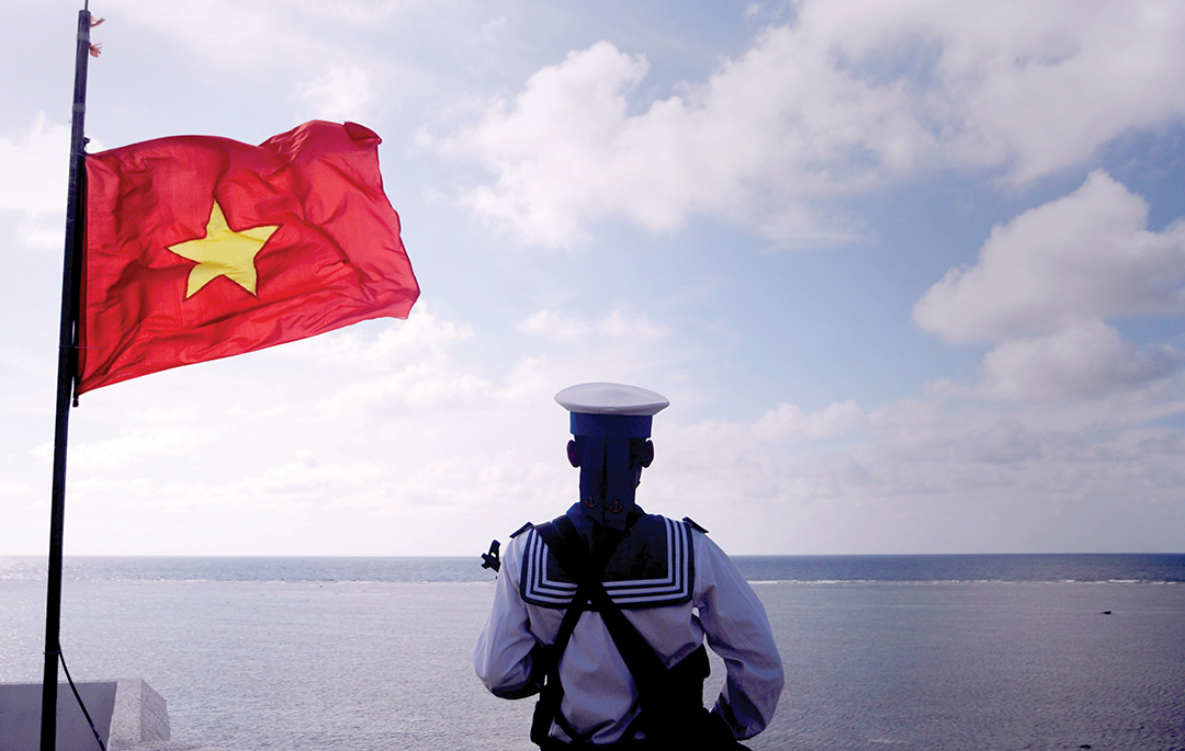 A Vietnamese Sailor stands guard at Thuyen Chai Island in the Spratly archipelago. REUTERS