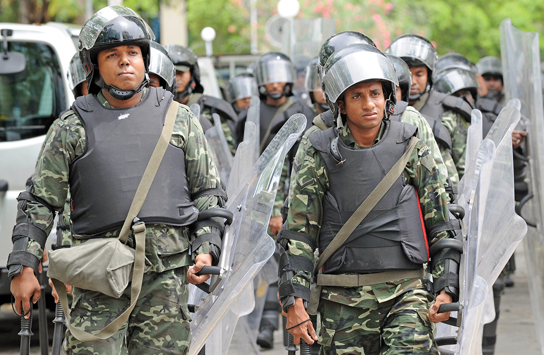 Maldivian Soldiers patrol in the capital, Male. AFP/GETTY IMAGES