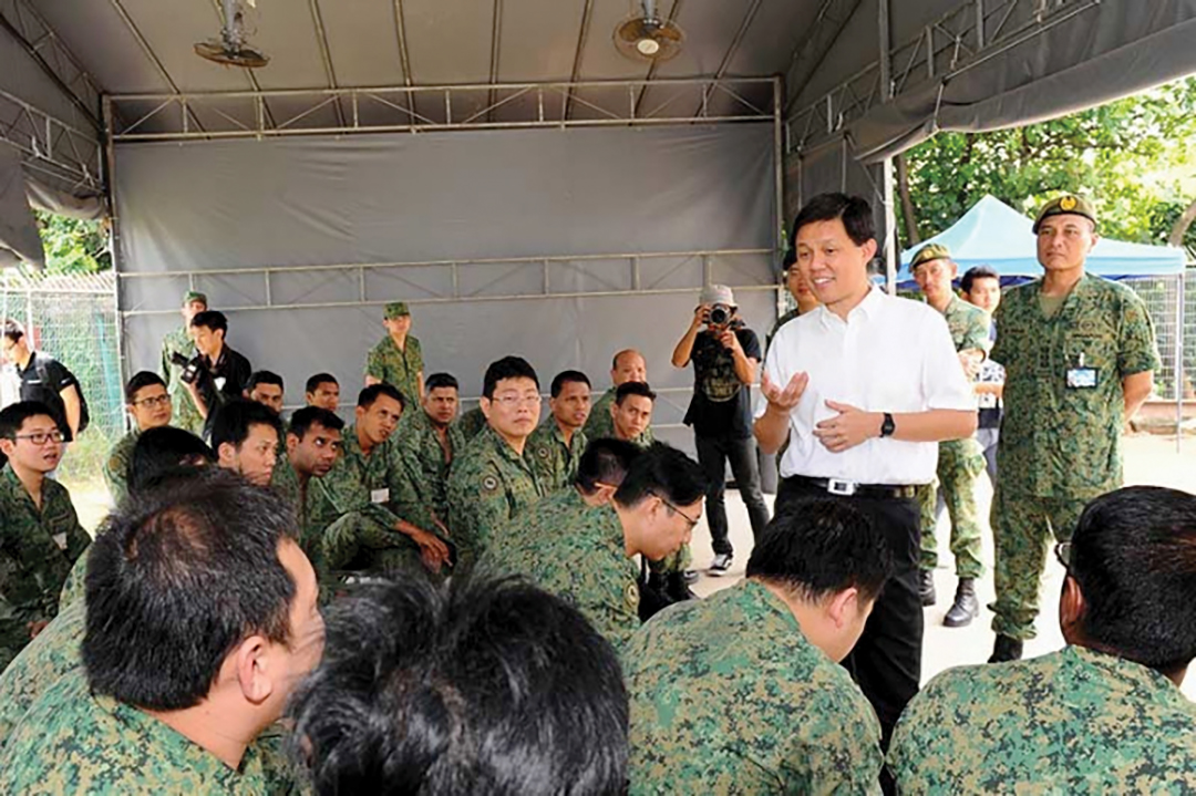 Chan Chun Sing, then Singapore's second minister for defence, left, in white shirt, speaks with Operationally-Ready National Servicemen from the 807th Battalion, Singapore Infantry Regiment in January 2015, stressing the importance of remaining vigilant against terrorism. SINGAPORE MINISTRY OF DEFENCE
