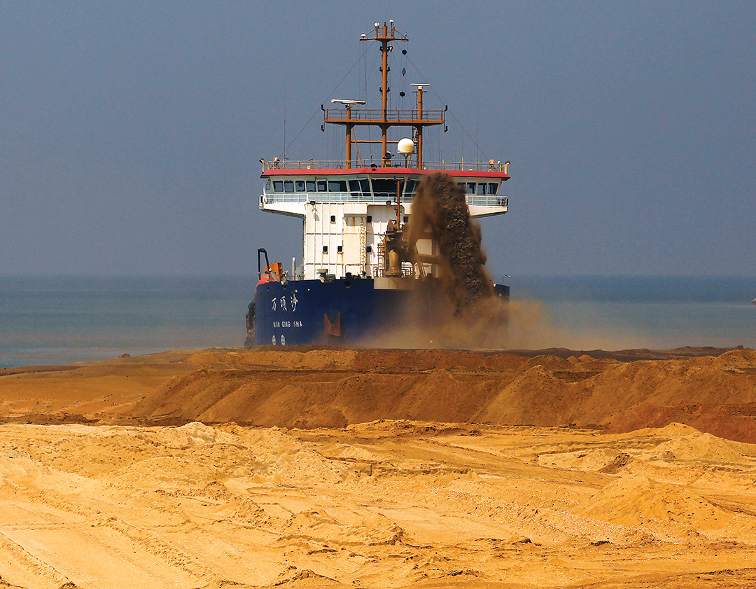 China typically dredges sand from the sea to create land, a process that can have detrimental environmental effects, especially in the fragile South China Sea islands.