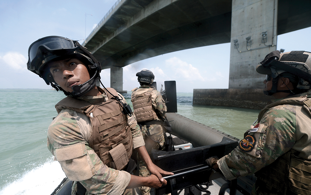 Indonesian Navy special forces and U.S. Navy Sailors practice interdiction techniques during Cooperation Afloat Readiness and Training in Indonesia in August 2015. PETTY OFFICER 1ST CLASS JOSHUA SCOTT/U.S. NAVY