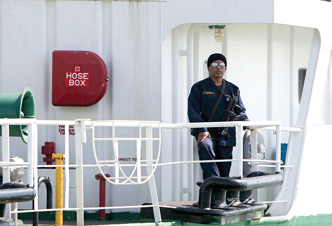 A Malaysian marine police officer guards the Naniwa Maru 1 at Klang port, Malaysia, after the tanker was robbed by pirates in April 2014. THE ASSOCIATED PRESS