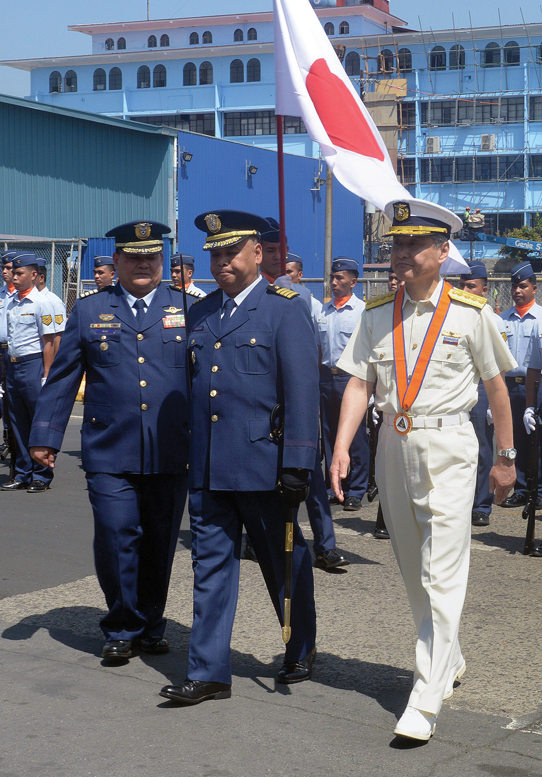 Adm. Yuji Sato, right, commander of Japan's Coast Guard, walks with senior Philippine Coast Guard personnel at Manila headquarters in May 2015. The two nations engaged in bilateral talks during the 5th Maritime Law Enforcement exercise to combat piracy and armed robbery at sea. AFP/GETTY IMAGES