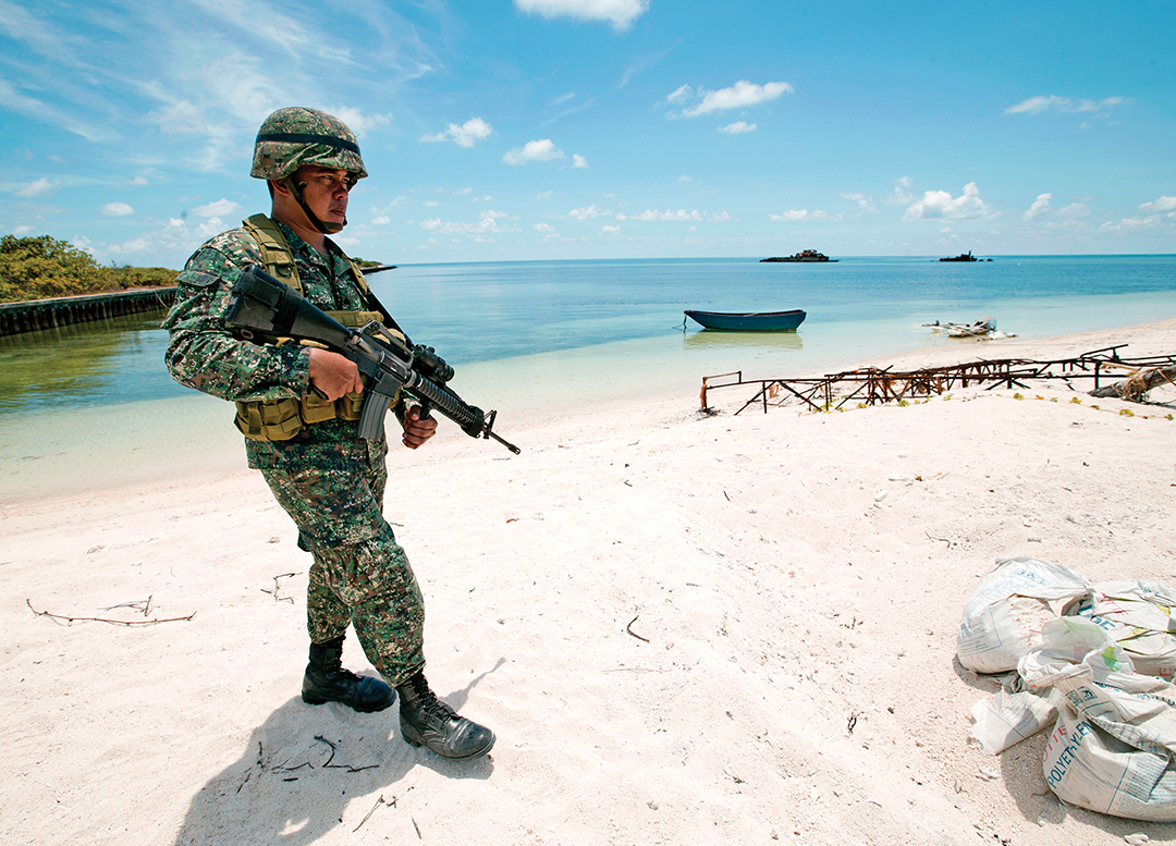 A Filipino Soldier patrols Pag-asa Island in May 2015, of the Spratly Islands in the South China Sea. THE ASSOCIATED PRESS