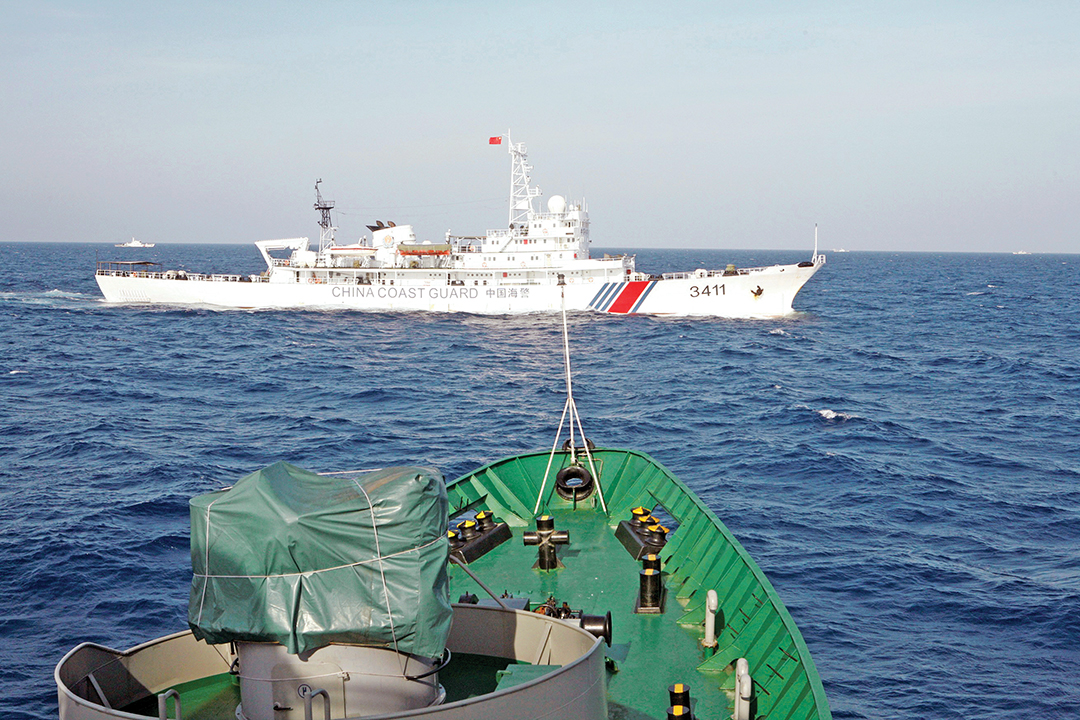A Chinese coast guard ship cruises near a Vietnam Coast Guard ship in May 2014 in the South China Sea, about 210 kilometers off Vietnam's shore. REUTERS