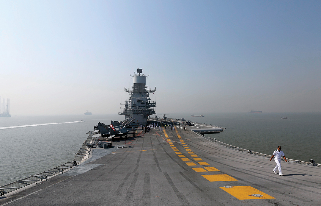 A crew member walks on the deck of INS Vikramaditya, one of the Indian Navy's aircraft carriers. REUTERS