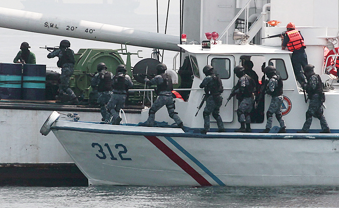 Philippine Coast Guard personnel board a ship during a seajacking scenario as part of the combined Philippine-Japan maritime exercise off Manila Bay in the South China Sea in May 2015.