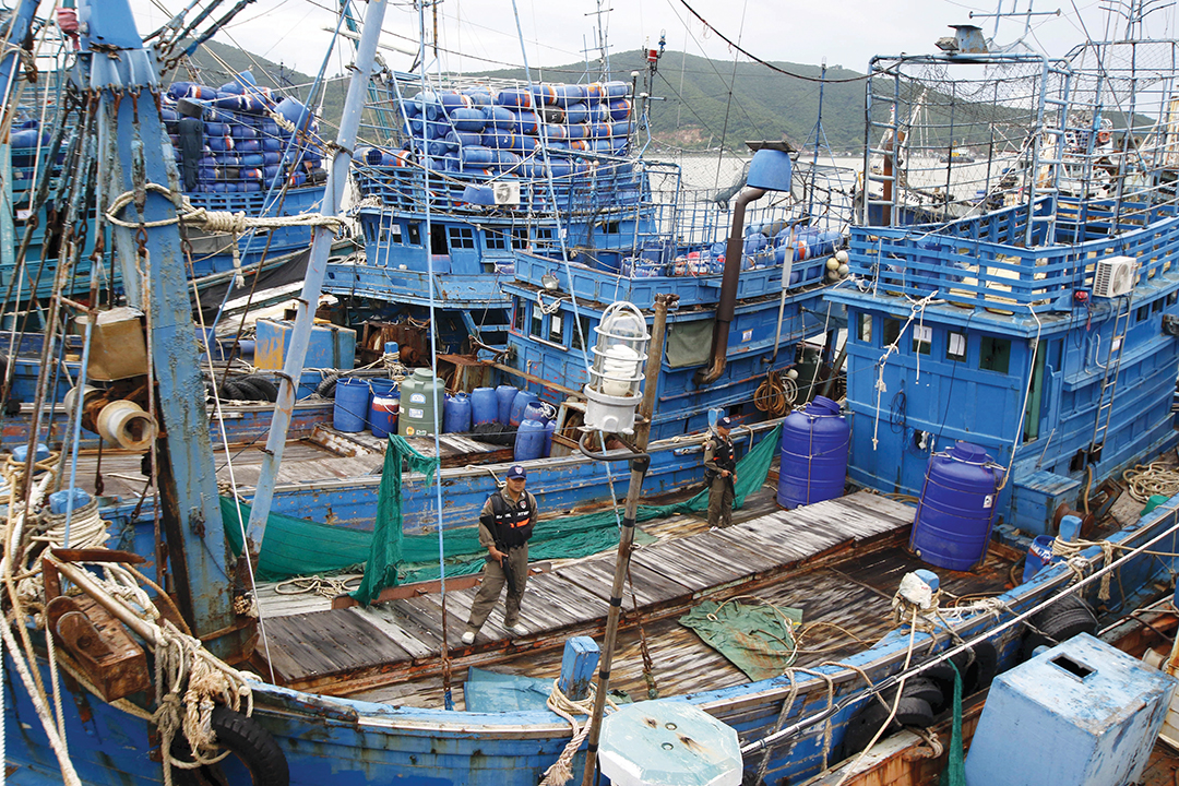 Police officers inspect a fishing boat at the pier of Songkhla, Thailand, in December 2015. Thai officials denied reports that seafood exports to the United States, Europe and Australia involved slavery and forced labor. Reuters