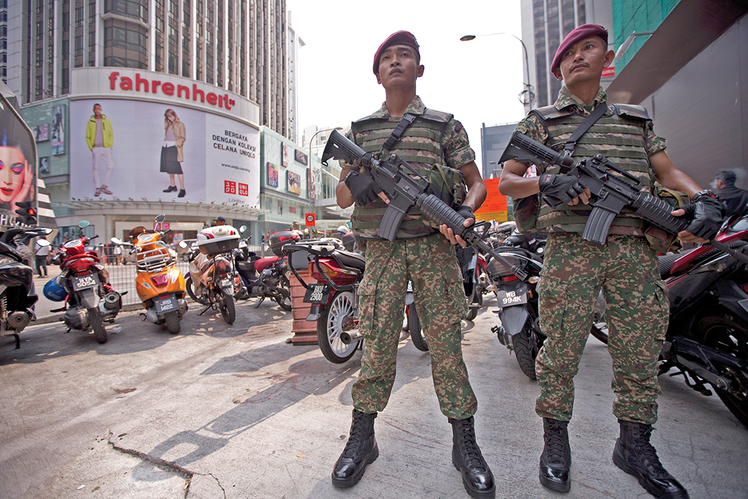 Malaysian Soldiers guard a Kuala Lumpur shopping area in February 2016 in response to terrorist threats. THE ASSOCIATED PRESS
