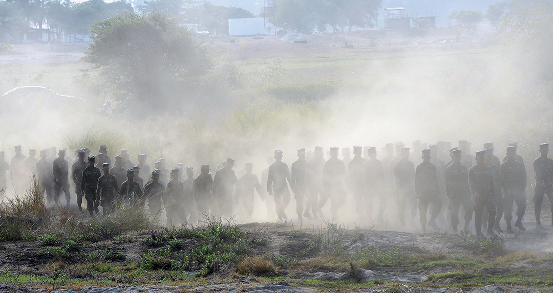 Philippine Navy personnel march on a San Antonio beach in April 2015 before an amphibious landing exercise in Zambales province as part of Balikatan, an annual joint war games exercise with U.S. troops. AFP/GETTY IMAGES