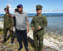 Philippine defense chief visits disputed Spratly island