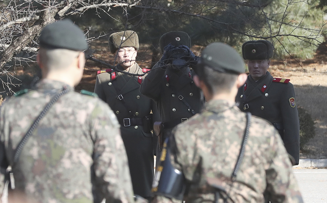 South Korean Soldiers fire warning rounds at North during defection