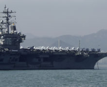 U.S. carrier docks in Hong Kong after bombers fly over South China Sea