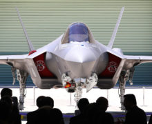 Japan adds to defense arsenal with an eye on Beijing