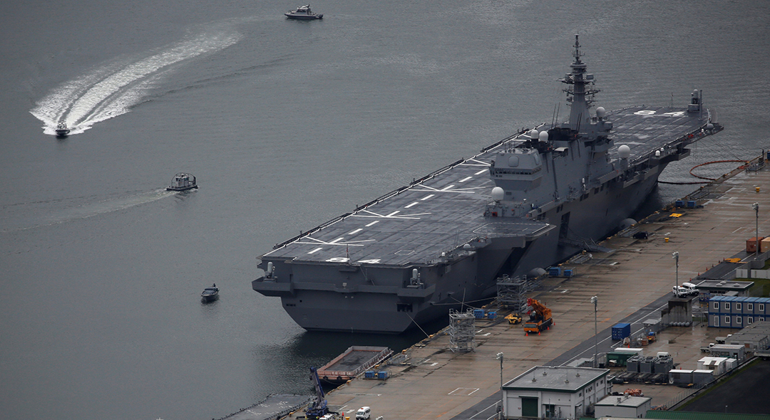 Japan to spend more on defense, refit first aircraft carrier