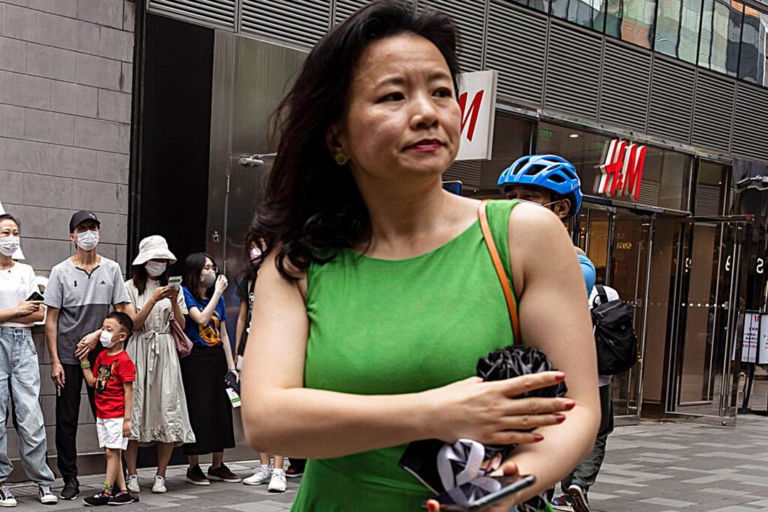 北京市内では、検温、マスク着用、個人情報のそれぞれの確認を行なっている(Kevin Frayer/Getty Images)