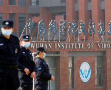 Report: Wuhan lab staff sought hospital care before COVID-19 outbreak disclosed